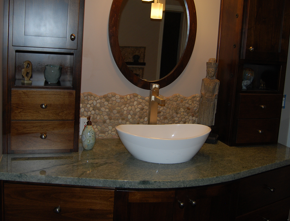 Green granite counter, vessel sink