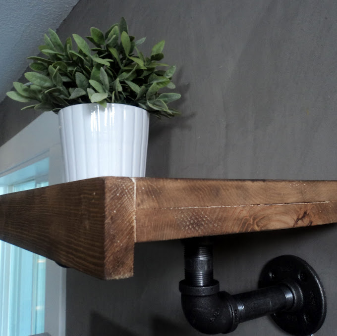 Homemade reclaimed wood and plumbers pipe shelf