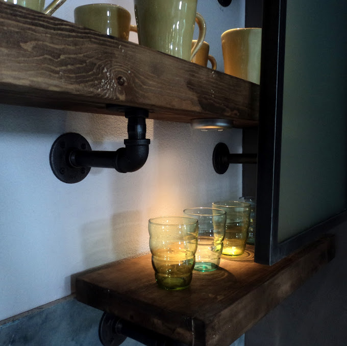 Homemade shelves with reclaimed wood and plumbers pipe