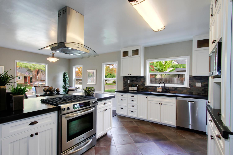 Black absolute honed granite white cabinet kitchen much for Black granite white cabinets kitchen