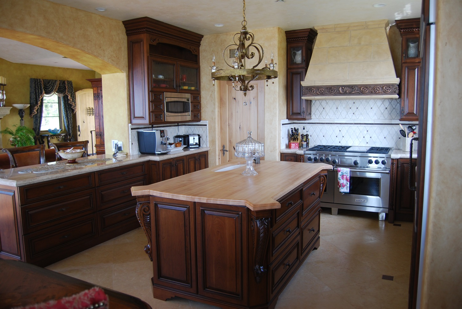 Dark cherry island and counter cabinets with corner detail