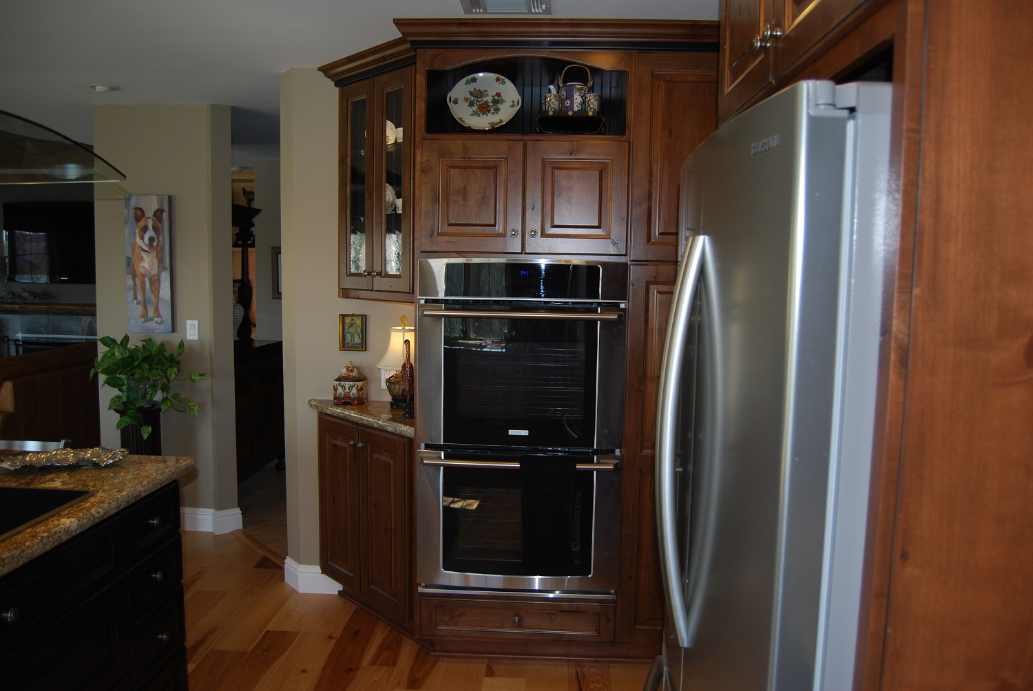 Double wall ovens with angled side cabinets