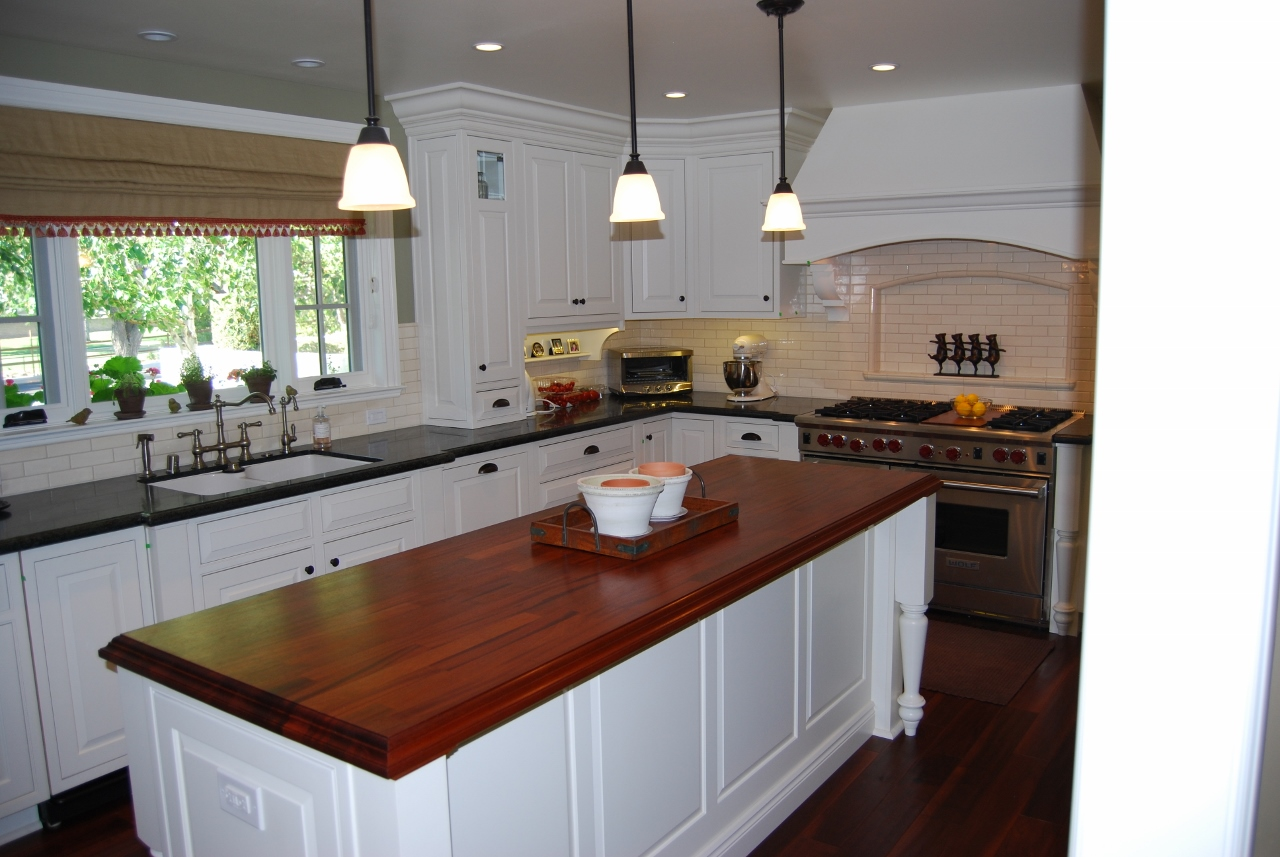Viking range, kitchen design, soapstone counters, pendant lights, subway tile back splash, brushed nickel faucet hardware