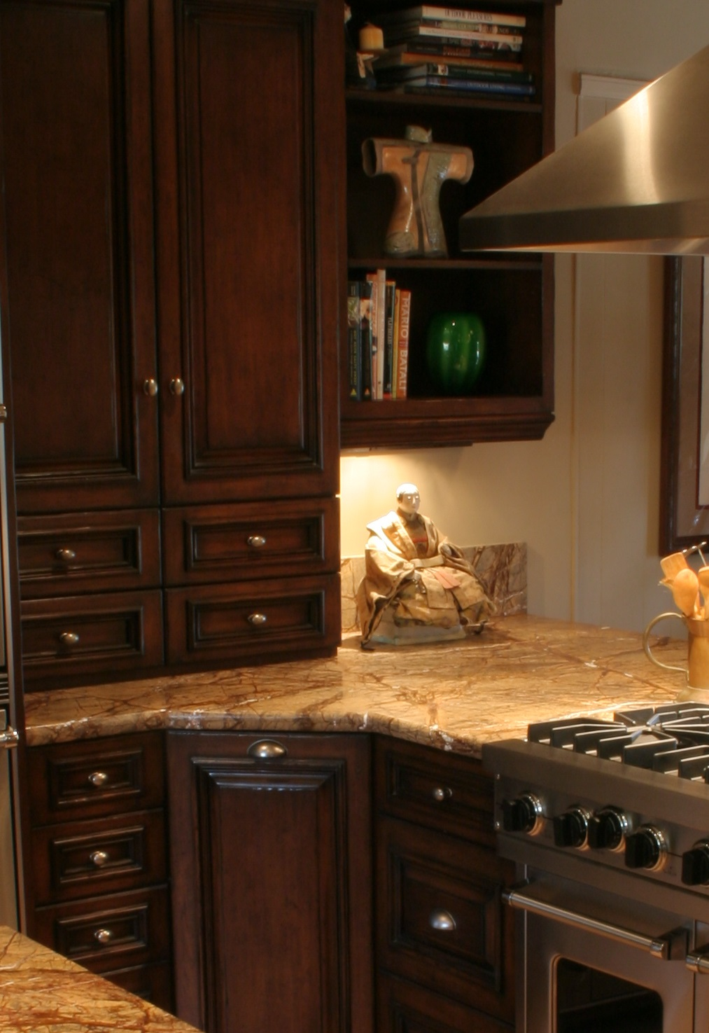 Finkel, wall cabinets with drawers, dark cabinets, rain Forest brown Granite counters, open book shelf