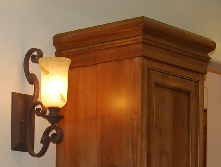 custom cabinet molding & wrought iron light
