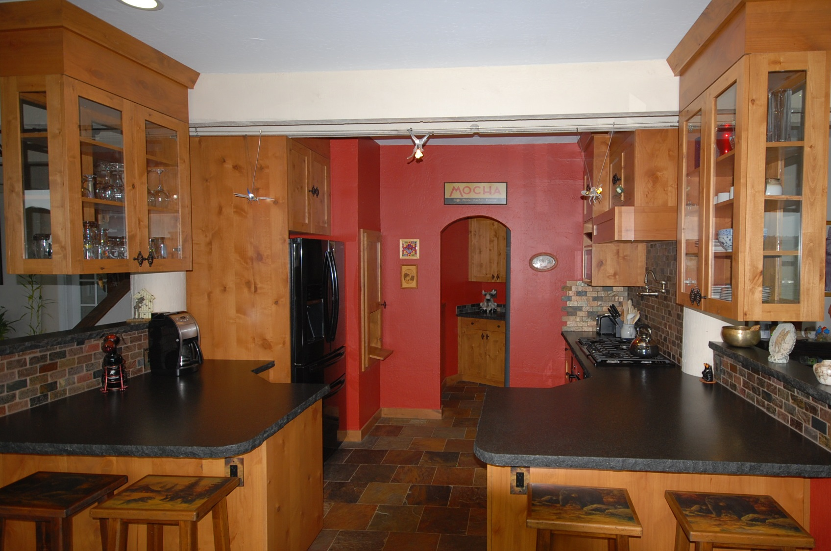 ... Alder Cabinets With Leathered Black Granite Counters