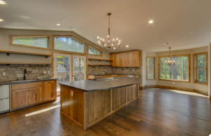 Rustic kitchen, hickory cabinets, leathered black granite counters, wrought iron fixtures and lighting, real rock veneer back Splash, clerestory windows, hard wood flooring